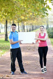 Young woman and man walking stock photos