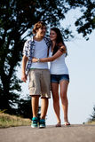 Young woman and man is walking on a road in summer outdoor Stock Photo