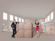 Young woman and man in warehouse Stock Images