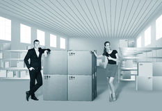 Young woman and man in warehouse Stock Photography