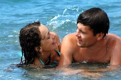 Young woman and man in water. Happy young woman and man in water Royalty Free Stock Photos