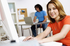 Young Woman and Man Working on Computers Royalty Free Stock Photography