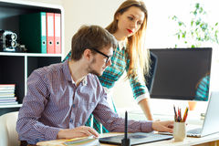 Young woman and man working from home - modern business concept Stock Image