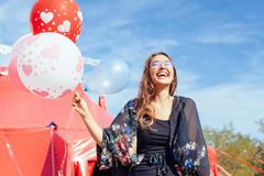 Young woman with many balloons Royalty Free Stock Photo