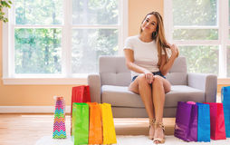 Young woman with many brightly colored shopping bags royalty free stock photos