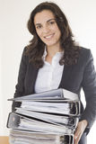Young woman with many folders stock image