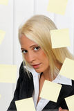 Young woman with many tasks and problems. Young business woman with multiple tasks saved labels Stock Image