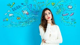 Young woman with many thoughts. On a blue background Stock Photo