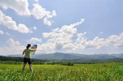 Young woman with map exploring a vast wilderness Royalty Free Stock Photos