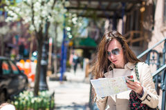 Young woman with map in historic district of West Stock Photos