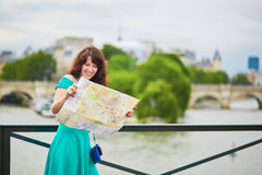 Young woman with map in Paris Royalty Free Stock Images