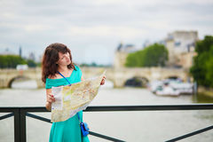Young woman with map in Paris Stock Photos