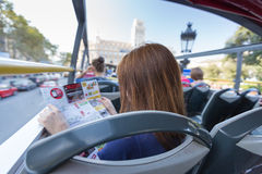 Young woman with map in touristic bus Stock Photography