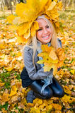 Young woman with maple garland Stock Images