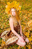 Young woman with maple garland Royalty Free Stock Photos