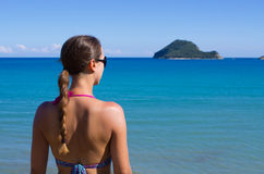 Young woman and Marathonisi island - Zakynthos, Greece Royalty Free Stock Photo