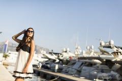 Young woman in marina Royalty Free Stock Photos