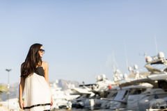 Young woman in marina Stock Photography