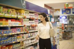 Young woman at the market. Young woman baying at the market stock image