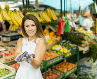 Young woman at the market Royalty Free Stock Image