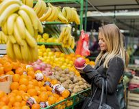 Young woman at the market Royalty Free Stock Photos