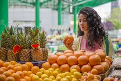 Young woman at the market Royalty Free Stock Images