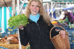 Young woman at the market buying a salad Stock Photo