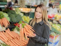 Young woman at the market Royalty Free Stock Photo