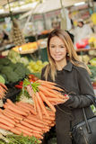 Young woman at the market Royalty Free Stock Photography