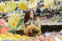 Young woman at the market Stock Photos