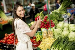 Young woman on the market. Young woman shopping on the market Royalty Free Stock Photos