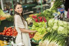 Young woman on the market. Young woman shopping on the market Stock Photos