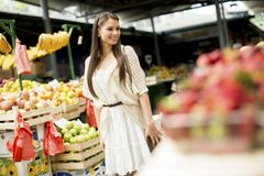 Young woman on the market. Young woman shopping on the market Royalty Free Stock Photo
