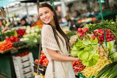Young woman on the market. Young woman shopping on the market Stock Photo