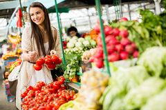 Young woman on the market Royalty Free Stock Images