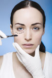 Young woman with marks on her face gets surgery Royalty Free Stock Images