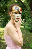 Young woman with mask Royalty Free Stock Image