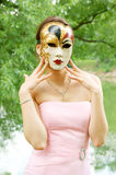 Young woman with mask Stock Images