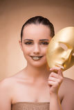 The young woman with mask in carnival concept. Young woman with mask in carnival concept Stock Images