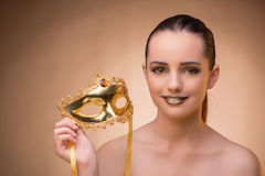 The young woman with mask in carnival concept. Young woman with mask in carnival concept Stock Photography