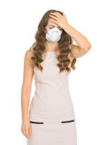Young woman in mask checking forehead temperature Royalty Free Stock Photography