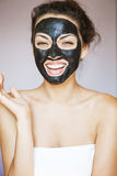 Young woman with a mask for the face of the therapeutic black mu Royalty Free Stock Image