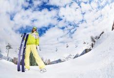 Young woman in mask holding ski fisheye view. Young woman in mask standing and holding ski fisheye view during sunny winter day on Krasnaya polyana ski resort Royalty Free Stock Photos