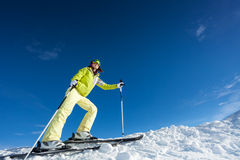 Young woman in mask holding ski poles and skiing. At Krasnaya polyana ski resort and Caucasus mountains in Sochi, Russia Royalty Free Stock Photos