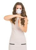 Young woman in mask showing stop gesture Royalty Free Stock Photos