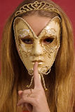 Young woman in mask shows gesture of silence Royalty Free Stock Photo