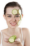 Young woman with mask from slice of a cucumber Royalty Free Stock Photo