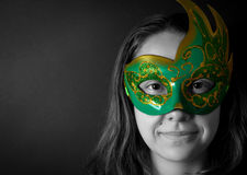 Young woman in mask. Smiling young woman in mask over black background Stock Photography