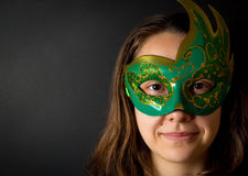 Young woman in mask. Smiling young woman in mask over black background Royalty Free Stock Image