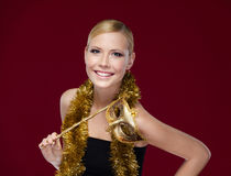 Young woman with masquerade mask and tinsel Royalty Free Stock Photo